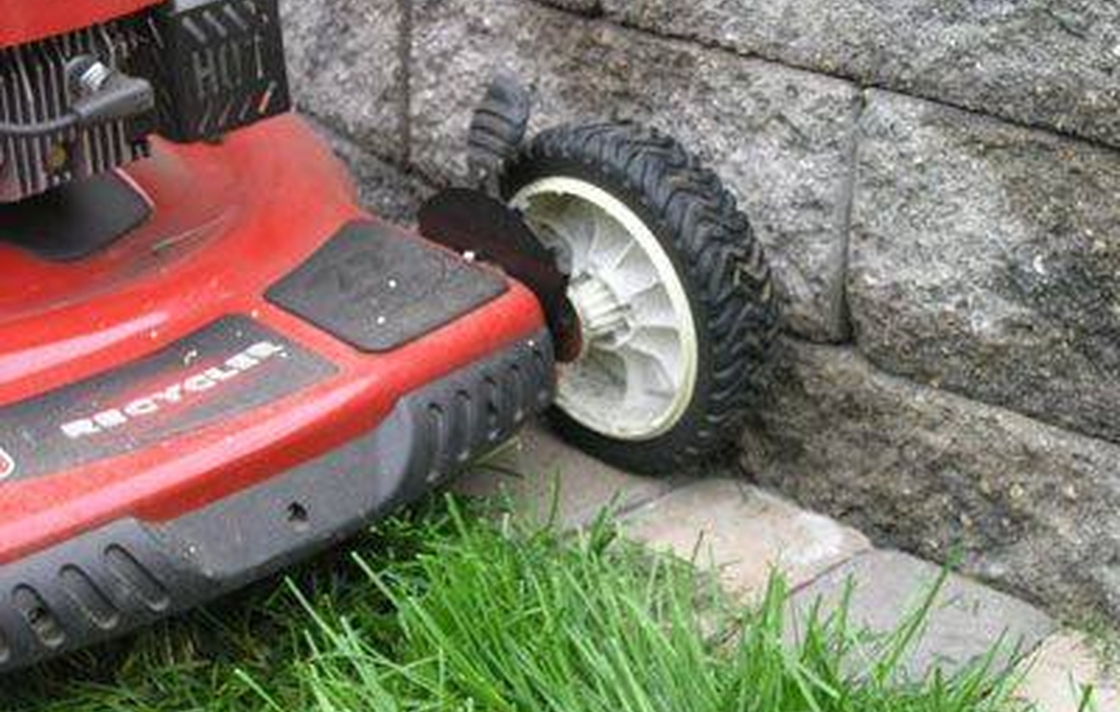 Adding a course of pavers along your yard helps eliminate trimming.