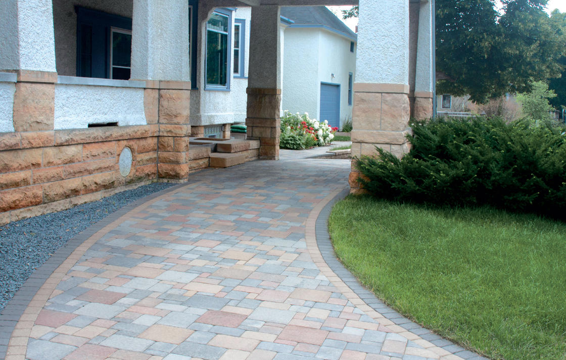 Cobblestone pavers in multi-colors for carport driveway.