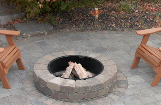 Enjoy a cozy fire ring on your new paver patio.